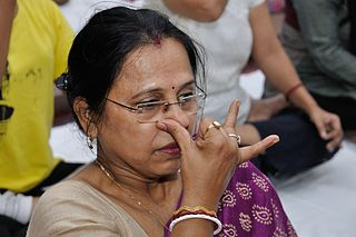 A woman perfoms Nadishodhana Pranayama at the International Day of Yoga Celebration at the National Council of Science Museums (NCSM), Kolkata, under the Ministry of Culture, Govt. of India in 2015
