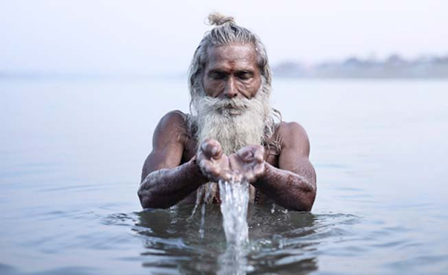 Photograph of a sadhu in a holy river by Joey L from the series 'Holy Men'