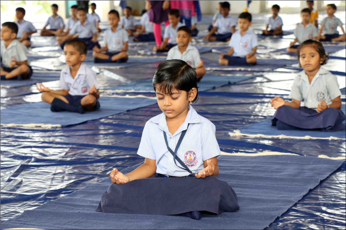 tudents of Naval Children School and Naval Kindergarten, Ezhimala participating in the mass yoga demonstration at Indian Naval Academy to commemorate the 3rd International Yoga Day 2017. Photo by the Indian Navy.